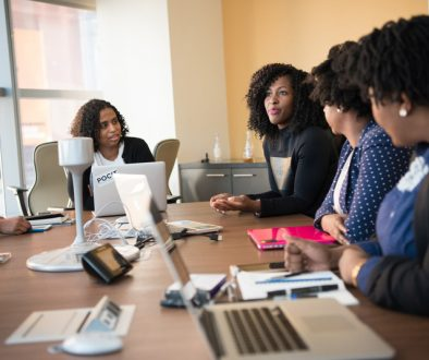 Canva - Four Woman at the Conference Room
