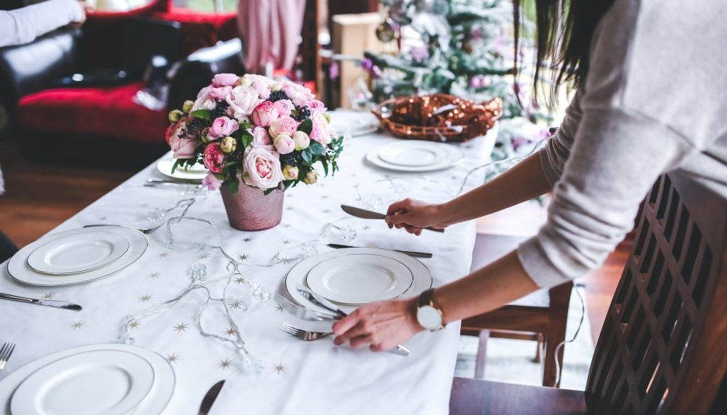 Canva - Woman Preparing Christmas Table