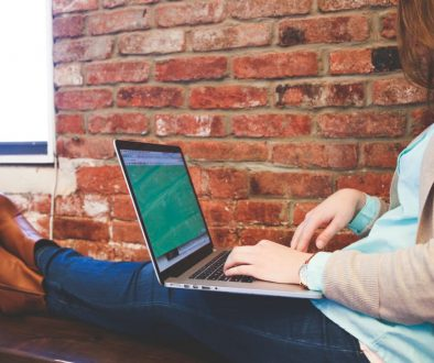 Canva - Woman Sitting on Bench Using Macbook