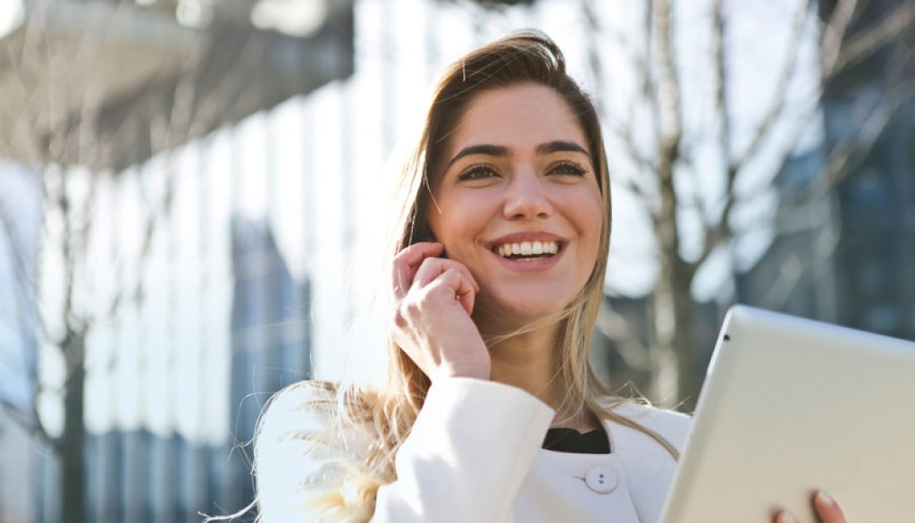 happy Canva - Woman In White Blazer Holding Tablet Computer