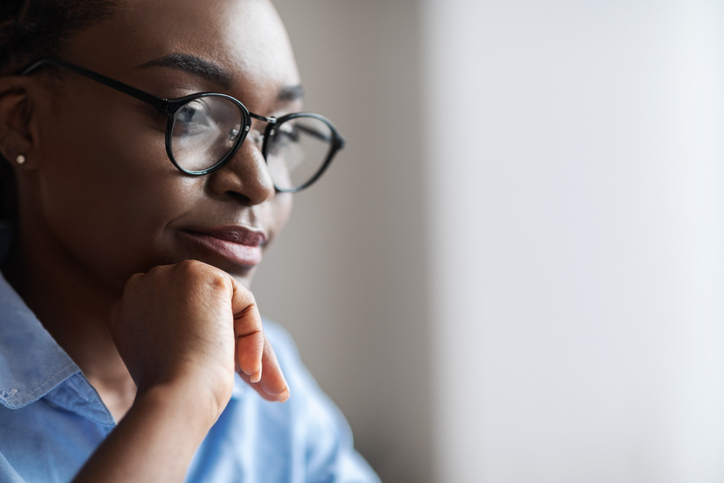 Closeup Indoor Portrait Of Black Female Business Analyst In Eyeglasses, Side View